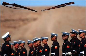 Marine rifles seemingly suspended in mid-air