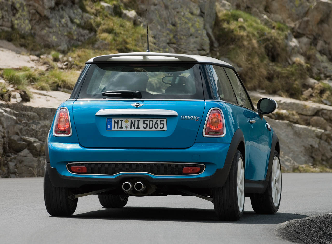 A side by side comparison of the 2003 MINI Cooper S and the new
