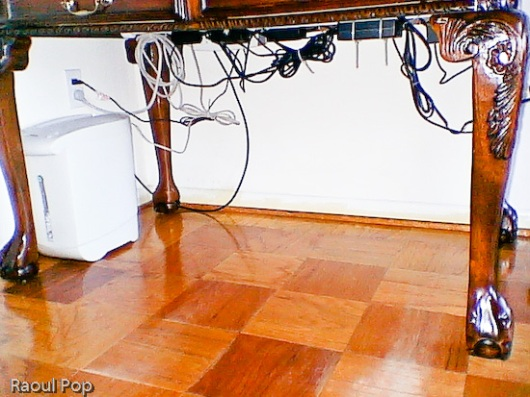 Underneath the desk with cable management in place