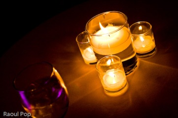 A glass of tonic water by candlelight