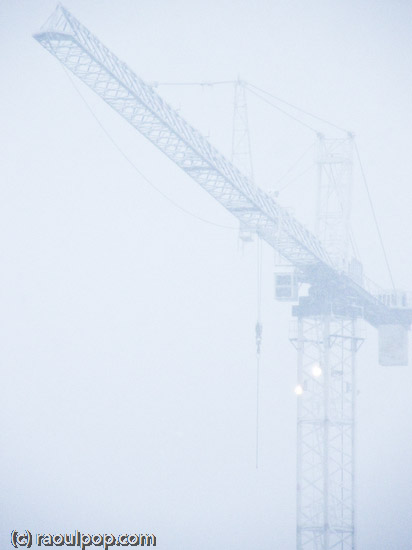 Tall crane during snowstorm