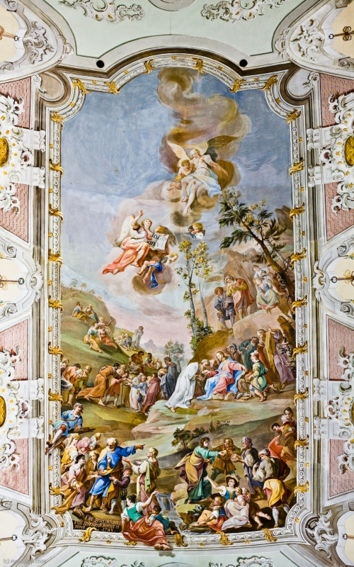 A panoramic photo (made of three individual 12 megapixel photos) showing the main ceiling mural of the Matrei cathedral, in Osttirol, Austria. The scene depicted is that of the feeding of the multitudes, where Jesus Christ multiplies a few loaves of bread and some fish to feed over 5,000 people. The original resolution of this panorama is 4209x5974 pixels.