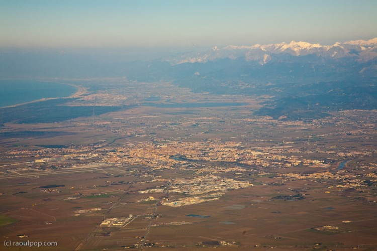 On a Ryanair flight above the city of Pisa, in Tuscany, Italy. The Mediterranean Sea is visible in the upper left.