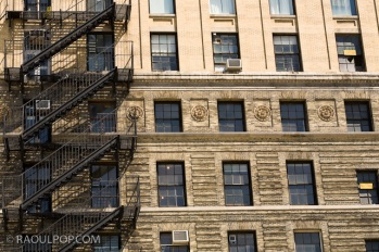 Iron ladder, windows, historic building, Manhattan, New York, USA.