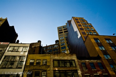 Looking upward, rooflines and buildings, Manhattan, New York, USA.