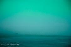 Dreamy fog over icy lake