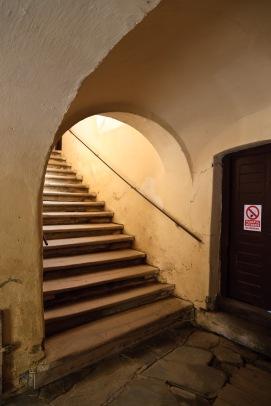 Climbing the steps that lead inside the inner walls, Biertan, Romania.