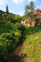 The village brook, Biertan, Romania.
