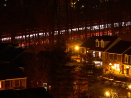 I-270 traffic and townhomes at night
