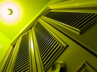 Abstract, metal doors with built-in blinds, green glow.