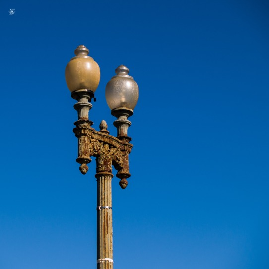 Rusty light post, wrought iron, Washington, DC, USA.