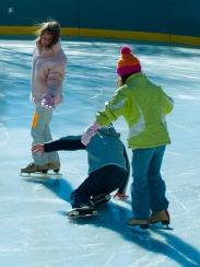 Children skating, Washington, DC, USA.