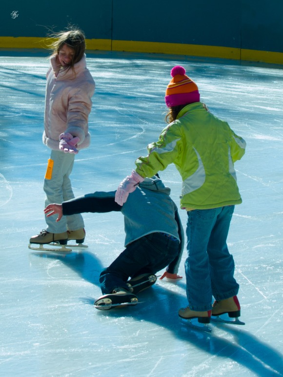 Children skating, Washington, DC, USA.