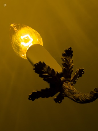 Candle-type bulb on an antique chandelier.