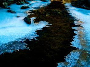 Partially frozen brook, winter, Cabin John Regional Park, MD, USA.