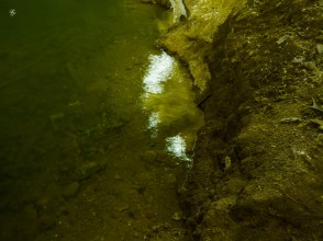 The underground lake shimmers
