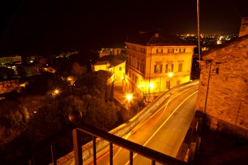 Nighttime above a street in Grottammare, Italy. Headlights and taillights leave streak marks in this long exposure.