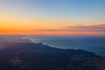 Above Pisa and Livorno, Italy. Not an ideal photo but the dawn colors were wonderful.