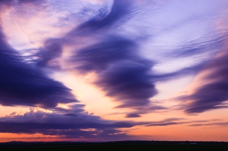 Windswept clouds at dawn