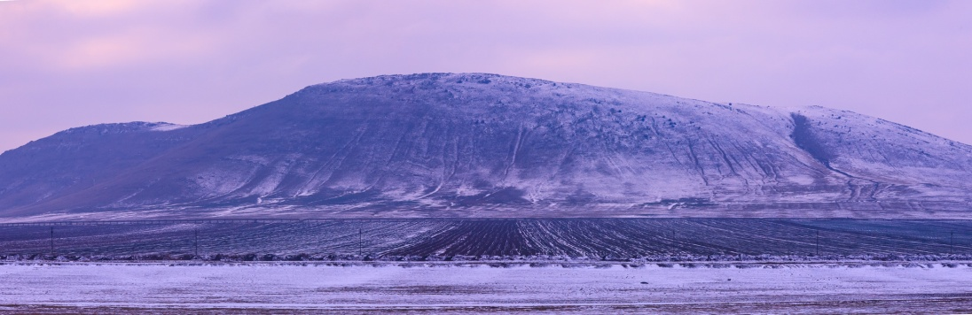 An old, old mountain in Dobrogea, worn down by winds and winters.