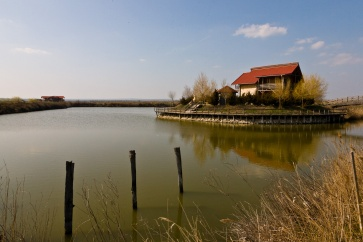 A villa sits on an island in a man-made lake near the Danube Delta, in Dobrogea, Romania.