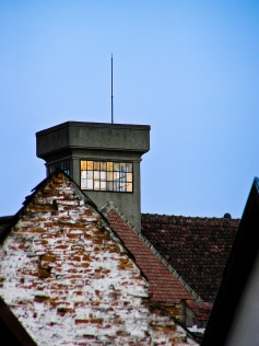 Dusk, a watch tower at the Roth school, Medias, Romania.