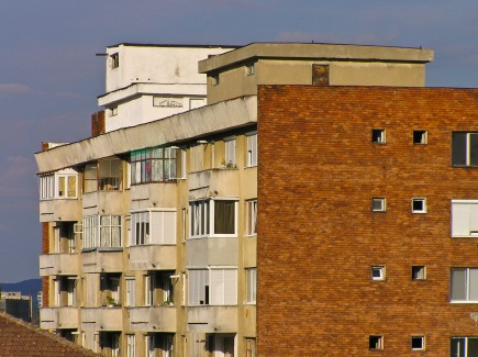 An older apartment building on a bright summer day, Medias, Romania.