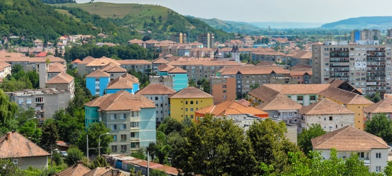 A cityscape of the city of Medias, Romania, showing some of the city's apartment buildings.