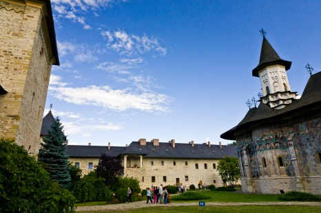 Interior courtyard, defense walls, cloisters and church, Manastirea Sucevita, Bucovina, Romania.
