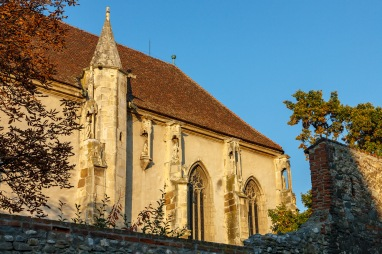 The wall was originally as high as it remains in the right side of the picture. It was lowered during the renovations, in order to make the church more visible from the outside. At the fortified church in Sebes, Transilvania, Romania.