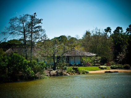 House on island in middle of lake, Morikami Museum and Japanese Gardens, Delray Beach, FL, USA.