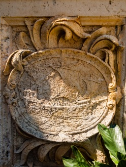 A ship carved into a stone emblem. Vizcaya, Miami, Florida, USA