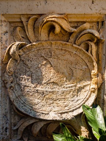 A ship carved into a stone emblem. Vizcaya, Miami, Florida, USA