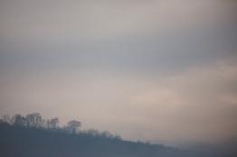 Morning fog over distant ridge