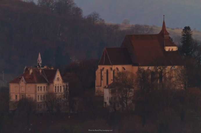 A view inside the fortified walls of Sighisoara, Romania, after sunset. What you see is the church, and one of the larger historic buildings.