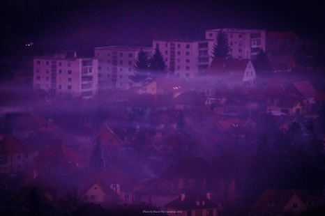 Fog sets in at twilight over the city of Sighisoara, Romania.