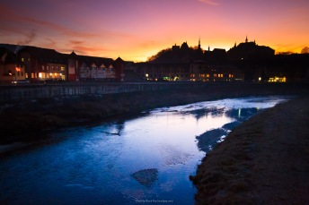 On a bridge in downtown Sighisoara, Romania, after sunset, as the dark begins to set in. The river is Tarnava Mare.